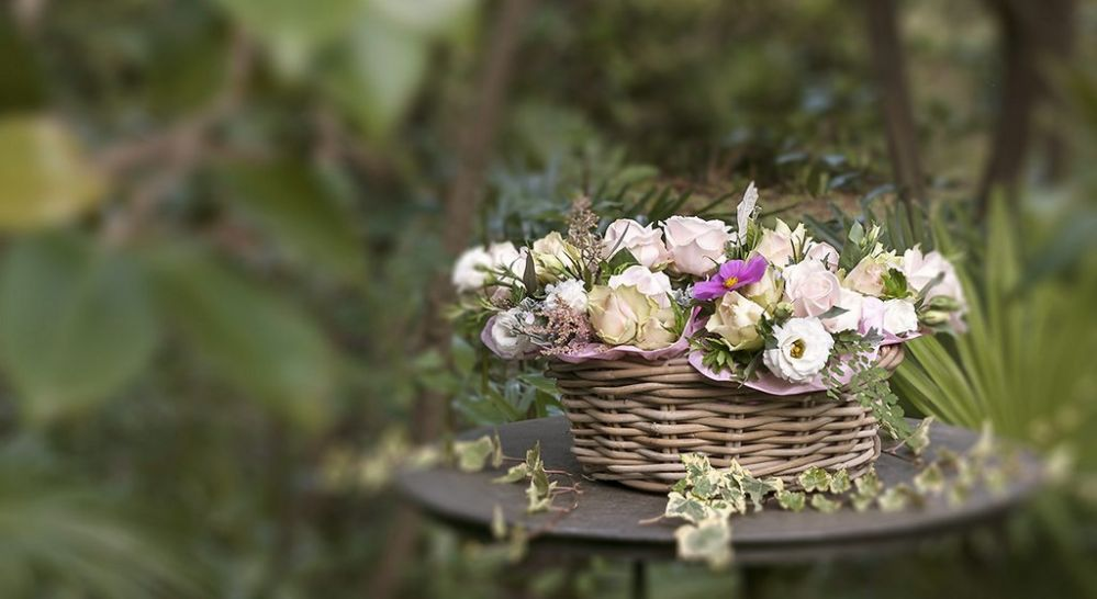 Wicker basket with small bouquets