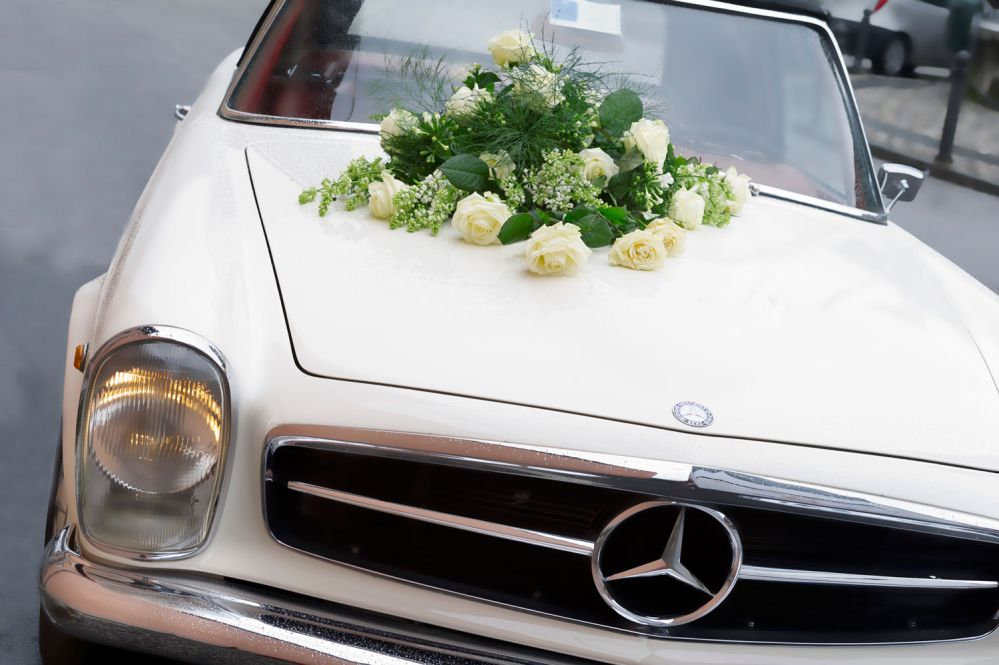Decorations for the bride and grooms car