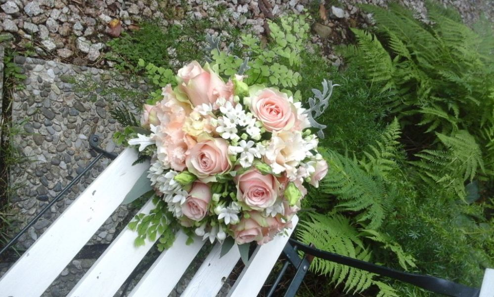 Bridal bouquet with roses and bouvardia